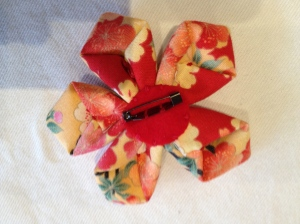 On Back of Origami flower I sewed a broach clip. They can be used for broaches, Shoes etc
