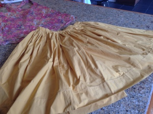 Kris completed mustard Tafatta  skirt, it can be worn as a top with belt or tie under the bust!!